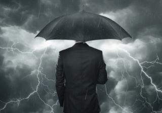 businessman adviser umbrella warn storm