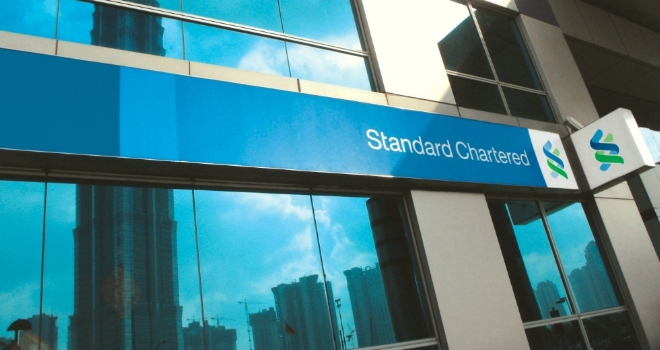 Standard Chartered to pay over $1B to resolve probes