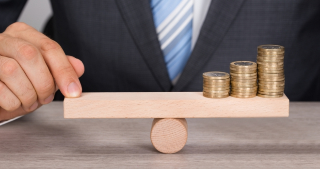 balance scales pound coin money business